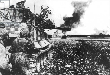 Paratroopers advancing behind a tiger tank during fighting in Lithuania, August 1944.jpg